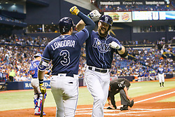 September 20, 2017 - St. Petersburg, Florida, U.S. - WILL VRAGOVIC       Times.Tampa Bay Rays right fielder Steven Souza Jr. (20) celebrates his solo home run with third baseman Evan Longoria (3) in the first inning of the game between the Chicago Cubs and the Tampa Bay Rays at Tropicana Field in St. Petersburg, Fla. on Wednesday, Sept. 20, 2017. (Credit Image: © Will Vragovic/Tampa Bay Times via ZUMA Wire)
