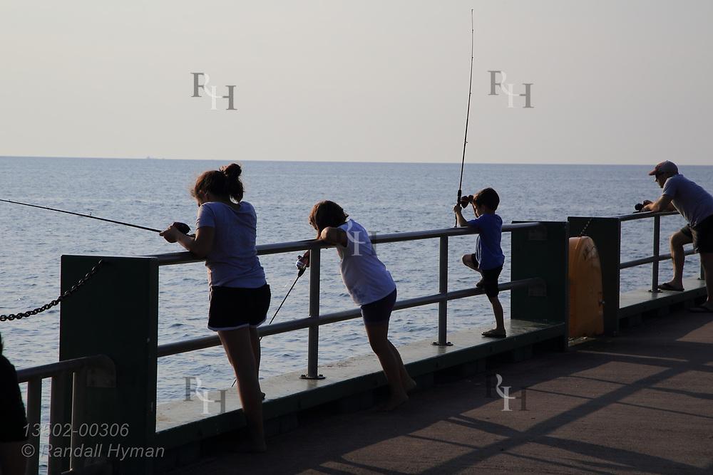 Kids fish from Miller Road Park pier on Lake Erie at Avon Lake, OH.