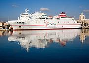 Juan J Sister Acciona Trasmediterranea shipping line Ro-Ro ferry ship moored in the port at Malaga, Spain