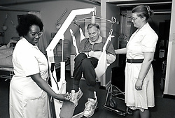 Nurses lifting an elderly patient using a hoist, City Hospital, Nottingham 1991 UK