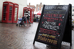 © Licensed to London News Pictures . 04/06/2014 . Newark , Nottinghamshire , UK . A board offering free drink to Quentin Letts of the Daily Mail in Newark today (Wednesday 4th June 2014) ahead of the Newark by-election tomorrow (Thursday 5th June 2014) . Photo credit : Joel Goodman/LNP