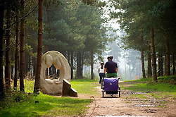 Cyclists pass artwork along The Route to Health walk and cycleway on Cannock Chase, Staffordshire, England, United Kingdom.