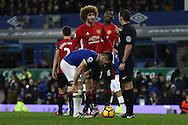 Marouane Fellaini of Manchester United talks with Referee Michael Oliver after a penalty was awarded against him late in the game. Premier league match, Everton v Manchester United at Goodison Park in Liverpool, Merseyside on Sunday 4th December 2016.<br /> pic by Chris Stading, Andrew Orchard sports photography.