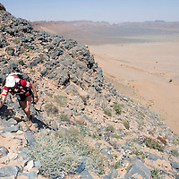 26 March 2007:  A runner reaches summit of jebel El Otfal, 947 meters and an average 25% slope, during the second stage (21.7 miles) of the 22nd Marathon des Sables between Khermou and jebel El Otfal. The Marathon des Sables is a 6 days and 151 miles endurance race with food self sufficiency across the Sahara Desert in Morocco. Each participant must carry his, or her, own backpack containing food, sleeping gear and other material.