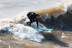 © Licensed to London News Pictures. 04/03/2016. Brighton, UK. People take advantage of the sunny weather to spend the afternoon surfing in Brighton. Today March 4th 2016. Photo credit: Hugo Michiels/LNP