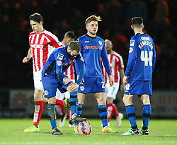 A dejected Rochdale side after conceding the second goal - Photo mandatory by-line: Matt McNulty/JMP - Mobile: 07966 386802 - 26/01/2015 - SPORT - Football - Rochdale - Spotland Stadium - Rochdale v Stoke City - FA Cup Fourth Round