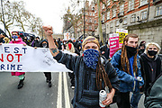 Demonstrators hold banners and flags during a 'Kill the Bill' protest outside New Scotland Yard in London on Saturday, April 3, 2021. The demonstration is against the contentious Police, Crime, Sentencing and Courts Bill, which is currently going through Parliament and would give police stronger powers to restrict protests. (Photo/ Vudi Xhymshiti)