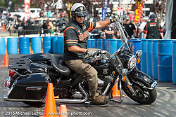 Rob Grimsley of Harley-Davidson police fleet sales demonstrates bike handling during the annual Sturgis Black Hills Motorcycle Rally.  SD, USA.  August 12, 2016.  Photography ©2016 Michael Lichter.