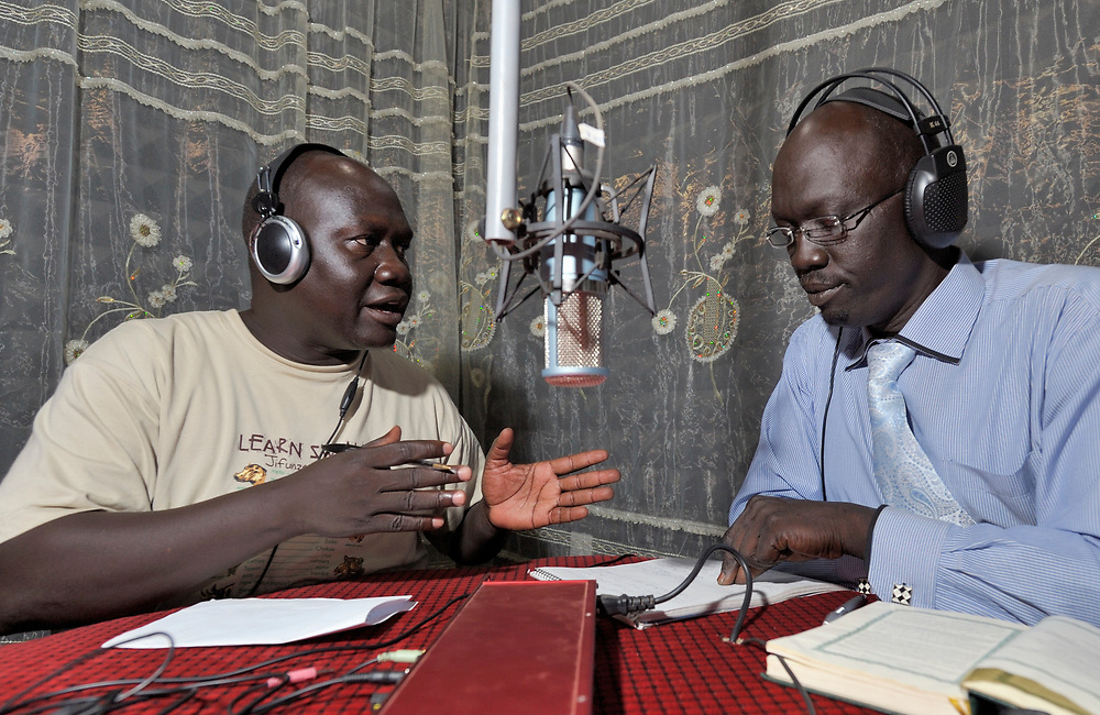 """Opi Ako Morris (left) co-hosts the morning """"Juba Sunrise"""" program on the Catholic Church-sponsored Radio Bakhita in Juba, the capital of Southern Sudan. He is interviewing Omar Sebit Lado, a local historian. NOTE: In July 2011 Southern Sudan became the independent country of South Sudan."""
