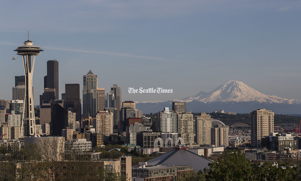 Clear skies bring out Mt. Rainier in the distance on a sunny April day in Seattle.<br /> <br /> Dean Rutz / The Seattle Times