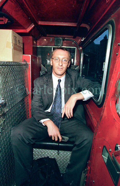 14 September 2001. New York, New York - USA.<br /> Post 9/11 World Trade Center attack.<br /> Andy Lines of London's Daily Mirror inside a firetruck on his way to file the story following his exclusive interview with Mike Kehoe from his firehouse on East 2nd Street in the East village early in the morning of Sept 14th. <br /> Mike's image had been published the day before on front pages around the world. It is the iconic image of him ascending the stairs of the World Trade Center as he helped to evacuate people from the terrorist attacks of 9/11. It was assumed Mike had perished when the buildings collapsed. However Mike had miraculously managed to escape the buildings moments before they collapsed. 6 members of his crew were not so fortunate. Mike became a symbol of heroism to many following the vicious Al Queda attacks which claimed over 2,000 victims at the WTC site. Andy's story was published exclusively on the Front Page of the Daily Mirror on 15th Sept, 2001.<br /> Photo exclusive©; Charlie Varley/varleypix.com