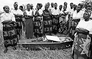 Bottom: There is a viewing for friends and family to see the body for the last time just before burial. After prayers, the coffin is covered and carefully placed in the grave. The same young men that dug the grave fill it back in with earth.