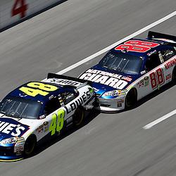 April 17, 2011; Talladega, AL, USA; NASCAR Sprint Cup Series driver Dale Earnhardt Jr. (88) bump drafts Jimmie Johnson (48) during the Aarons 499 at Talladega Superspeedway.   Mandatory Credit: Derick E. Hingle