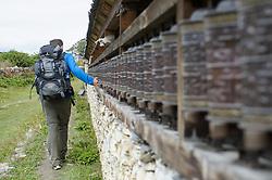 THEMENBILD - Trekkingtour in Nepal um die Annapurna Gebirgskette im Himalaya Gebirge. Das Bild wurde im Zuge einer 210 Kilometer langen Wanderung im Annapurna Gebiet zwischen 01. September 2012 und 15. September 2012 aufgenommen. im Bild Wanderer dreht Gebetsmühlen // THEME IMAGE FEATURE - Trekking in Nepal around Annapurna massif at himalaya mountain range. The image was taken between september 1. 2012 and september 15. 2012. Picture shows Hiker and prayer mills, NEP, EXPA Pictures © 2012, PhotoCredit: EXPA/ M. Gruber