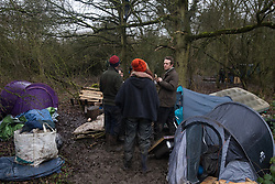 Harefield, UK. 14 January, 2020. Stop HS2 activists at a protection camp close to Harvil Road from which enforcement agents working on behalf of HS2 are attempting to remove them. Part of the nearby Colne Valley protection camp was evicted by bailiffs last week. 108 ancient woodlands are set to be destroyed by the high-speed rail link and further destruction of trees for HS2 in the Harvil Road area is believed to be imminent.