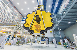 Apr 25, 2017 - Greenbelt, Maryland, U.S. - It's springtime and the deployed primary mirror of NASA's James Webb Space Telescope looks like a spring flower in full bloom. NASA technicians lifted the telescope using a crane and moved it inside a clean room at NASA's Goddard Space Flight Center in Greenbelt, Maryland. Once launched into space, the Webb telescope's 18-segmented gold mirror is specially designed to capture infrared light from the first galaxies that formed in the early universe, and will help the telescope peer inside dust clouds where stars and planetary systems are forming today. (Credit Image: ? Desiree Stover/NASA/ZUMAPRESS.com)