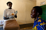 A nurse at the Saint Bakhita Health Centre in Yao speaks with a new mother about HIV.