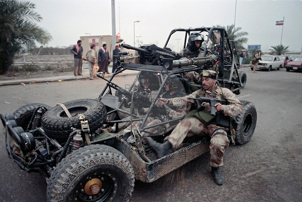 US Navy SEAL commandos arrive at the U.S. Embassy in Kuwait City in a Desert Patrol Vehicle during the liberation of Kuwait City in the Gulf War February 26, 1991 in Southern Iraq.