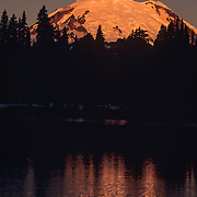 North America, United States, Northwest, Pacific Northwest, Washington, Mt. Rainier, Mt. Rainier National Park<br /> Massive Mount Rainier reflects in the icy waters of Tipsoo Lake at dawn, Mt. Rainier National Park, WA.