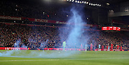 Fans of Manchester City set off flares during the English Premier League match at Anfield Stadium, Liverpool. Picture date: December 31st, 2016. Photo credit should read: Lynne Cameron/Sportimage