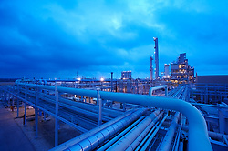 Stock photo of a refinery's structure and piping