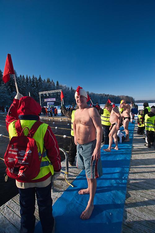 The competitor Tapani Korkeamaki concentrates before Finnish Ice Swimming Championships in Ellivuori, Finland.