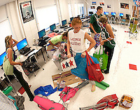 Natalie Compton gathers the Class of 2016's 4th of July props and decorations in preparation of Laconia High School's Homecoming festivities on Friday afternoon.  (Karen Bobotas/for the Laconia Daily Sun)