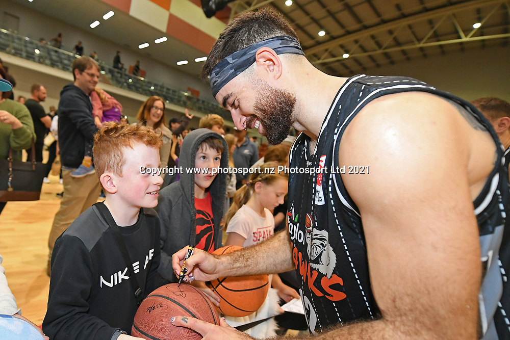 Taylor Hawks Ethan Rusbatch signs autographs for fans following the Sal's NBL Basketball match, Taylor Hawks v EnviroNZ Bulls, Pettigrew Green Arena, Napier, Saturday, June 26, 2021. Copyright photo: Kerry Marshall / www.photosport.nz
