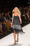 A gray and black knit dress with spaghetti straps and fringed hem.