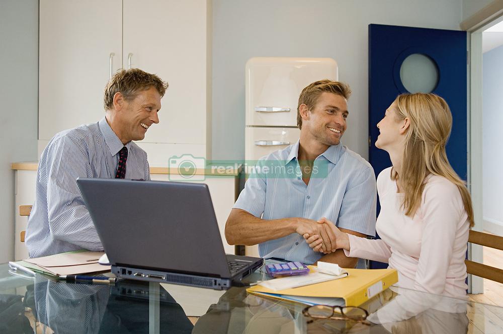 Dec. 14, 2012 - Couple and financial adviser (Credit Image: © Image Source/ZUMAPRESS.com)