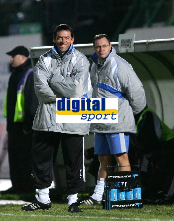 Photo: Frances Leader.<br />Brighton & Hove Albion v Derby County. Coca Cola Championship. 26/11/2005.<br />Derby's manager Phil Brown (L) laughs as Brighton fans chant that he is going to get the sack.