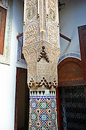 Arabesque Moorish plasterwork column capitals and zellij tiles of the Dar Jamai Museum  a typical dwellings of high Moroccan bourgeoisie at the end of XIX century. located in the old Medina built by Mohamed Ben Larbi Jamai grend vizier of Sultan Moulay Hassan (1873-1894). Meknes, Morocco .<br /> <br /> Visit our MOROCCO HISTORIC PLAXES PHOTO COLLECTIONS for more   photos  to download or buy as prints https://funkystock.photoshelter.com/gallery-collection/Morocco-Pictures-Photos-and-Images/C0000ds6t1_cvhPo<br /> .<br /> <br /> Visit our ISLAMIC HISTORICAL PLACES PHOTO COLLECTIONS for more photos to download or buy as wall art prints https://funkystock.photoshelter.com/gallery-collection/Islam-Islamic-Historic-Places-Architecture-Pictures-Images-of/C0000n7SGOHt9XWI