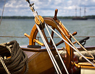 A ship's wheel and rigging during the Perry 200 Commemoration, September 2013, Erie Pennsylvania, USA