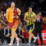 Galatasaray's Ermal KURTOGLU (L) during their Turkish Basketball league Play Off Final third leg match Galatasaray between Fenerbahce Ulker at the Abdi Ipekci Arena in Istanbul Turkey on Thursday 09 June 2011. Photo by TURKPIX