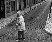 Crossing the Street. Morning Street Photography in Lisbon. Image taken with a Leica CL camera and 23 mm f/2 lens.