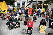 Protesters bow their heads at the Extinction Rebellion 'Shell Out' protest on 8th September 2020 in London, United Kingdom. The environmental group gathered outside the Shell building to protest at the ongoing extraction of fossil fuels and the resulting environmental record. Extinction Rebellion is a climate change group started in 2018 and has gained a huge following of people committed to peaceful protests. These protests are highlighting that the government is not doing enough to avoid catastrophic climate change and to demand the government take radical action to save the planet.