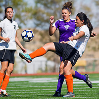 100612       Cable Hoover<br /> <br /> Gallup Bengal Felicia Benally (18) kicks the ball high and away from Miyamura Patriot Ariana Aretino (5) Saturday at Public School Stadium.