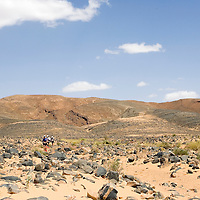 26 March 2007:  Participants run across a very rocky plain during the second stage (21.7 miles) of the 22nd Marathon des Sables between Khermou and jebel El Otfal. The Marathon des Sables is a 6 days and 151 miles endurance race with food self sufficiency across the Sahara Desert in Morocco. Each participant must carry his, or her, own backpack containing food, sleeping gear and other material.