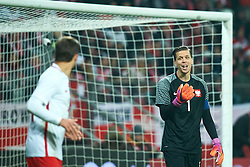 Wroclaw, Poland - 2016 November 14: (R) Goalkeeper Wojciech Szczesny of Poland speaks with teammate during Poland v Slovenia - International Friendly Soccer Match at Municipal Stadium on November 14, 2016 in Wroclaw, Poland.<br /> <br /> Adam Nurkiewicz declares that he has no rights to the image of people at the photographs of his authorship.<br /> <br /> Picture also available in RAW (NEF) or TIFF format on special request.<br /> <br /> Any editorial, commercial or promotional use requires written permission from the author of image.<br /> <br /> Mandatory credit:<br /> Photo by © Adam Nurkiewicz / Mediasport