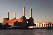 Battersea Power Station illuminated by the rising sun on a clear January day in London