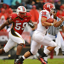 Sep 26, 2009; College Park, MD, USA; Maryland linebacker Demetrius Hartsfield (59) tracks Rutgers running back Joe Martinek (38) during the first half of Rutgers' 34-13 victory over Maryland in NCAA college football at Byrd Stadium.