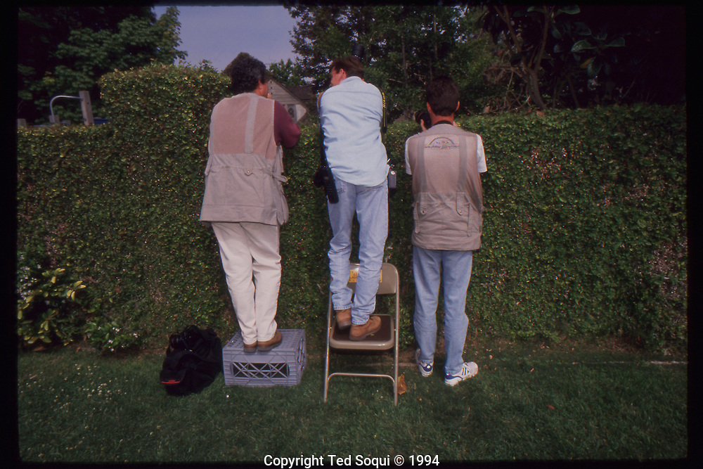 The OJ Simpson trial and media circus.<br /> Media photographers taking photos of OJ Simpson's Brentwood home.