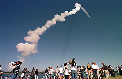 KENNEDY SPACE CENTER - Members of the media watch as the space shuttle Discovery lifts off from the Kennedy Space Center, at 2:19 p.m Thursday, Oct. 29, 1998, with U.S. Senator John Glenn aboard, for his historic return to space. Glenn, 77, the first American to orbit the earth, is now the oldest person to ever fly in space. (Photo / Jock Fistick
