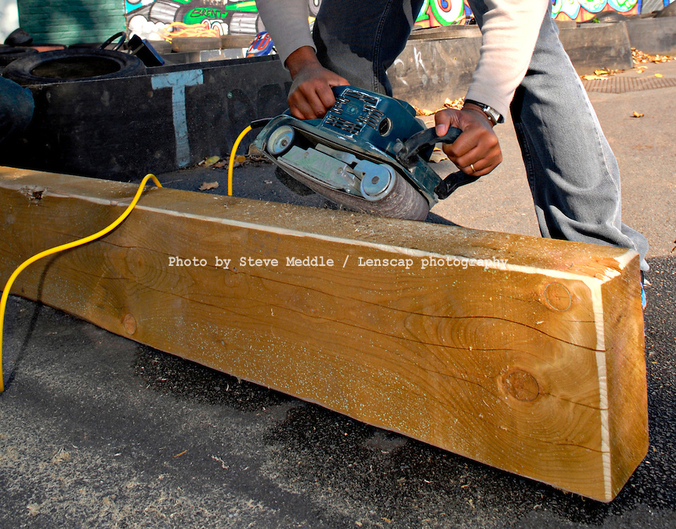 Person using Electric Power Sander