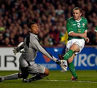 Photo. Jed Wee.<br /> Republic of Ireland v Brazil, International Friendly, Lansdowne Road, Dublin. 18/02/2004.<br /> Ireland's Stephen Carr (R) has a point blank effort saved by Brazilian goalkeeper Dida.