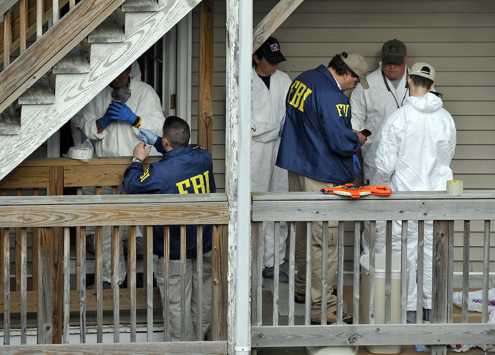 FBI search a house where Faisal Shahzad, a suspect in the Times Square car bomb attempt, lived in Bridgeport, Conn.  Shahzad was taken into custody late Monday by FBI agents and New York Police Department detectives while trying to leave the country. (AP Photo/Jessica Hill)