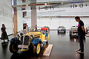 Visitor at BMW Museum views BMW 35 1934 model car on display at the BMW Headquarters in Munich, Bavaria, Germany