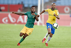 17/04/2018. Teboga Langerman of Mamelodi Sundowns FC fights for the ball with Knox Mutizwa of Lamontville Golden Arrows FC during their PSL match at Loftus Verfeld stadium.<br /> Picture: Oupa Mokoena/African News Agency (ANA)