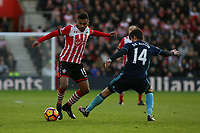Football - 2016 / 2017 Premier League - Southampton vs. Middlesbrough<br /> <br /> Southampton's Sofiane Boufal skips past the challenge of Marten de Roon of Middlesbrough at St Mary's Stadium Southampton England<br /> <br /> COLORSPORT/SHAUN BOGGUST