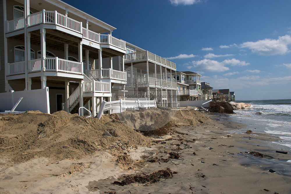 Section of Ocean Isle Beach, NC where the ocean has reclaimed land, homes and a large section of 2nd Street due to rising tides and erosion. About 3,800 homes are packed together on the narrow seven-mile long Ocean Isle. The rising ocean has worn away at the eastern end, where streets and lots have been steadily disappearing.